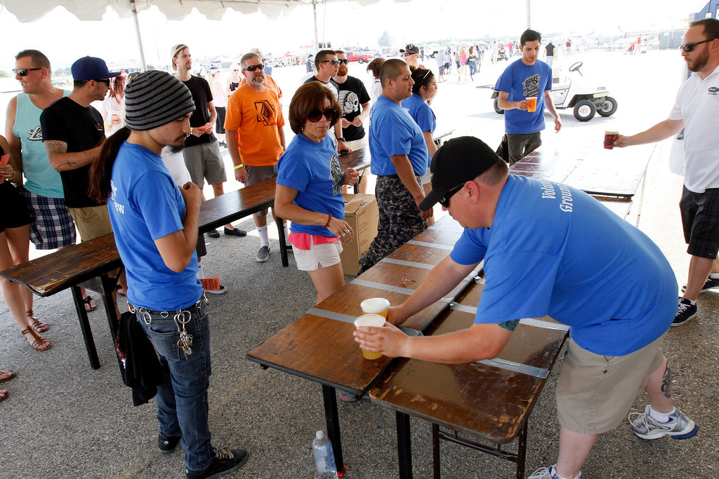 . Cups of beer are sold at the Hangar 24 AirFest and 6th Anniversary Celebration on Friday, May 16, 2014 at the Redlands Municipal Airport in Redlands, Ca. (Photo by Micah Escamilla/Redlands Daily Facts)