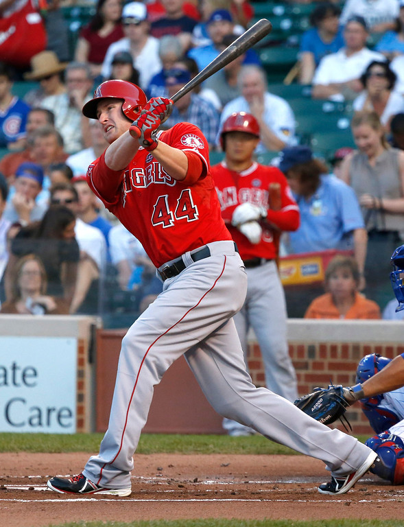 . Los Angeles Angels\' Mark Trumbo watches his home run off Chicago Cubs starting pitcher Jeff Samardzija during the first inning of an interleague  baseball game Wednesday, July 10, 2013, in Chicago. (AP Photo/Charles Rex Arbogast)