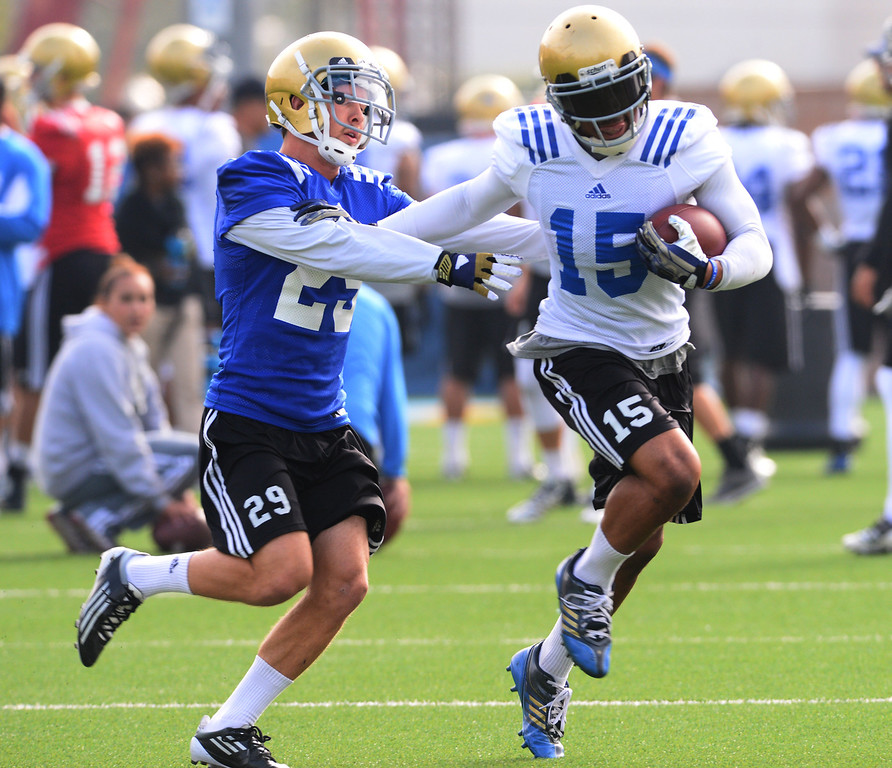 . UCLA football spring practice at Spaulding Field.  29 Erik Zumwalt and 15 Devin Lucien. (Apr.16, 2014 Photo by Brad Graverson/The Daily Breeze)