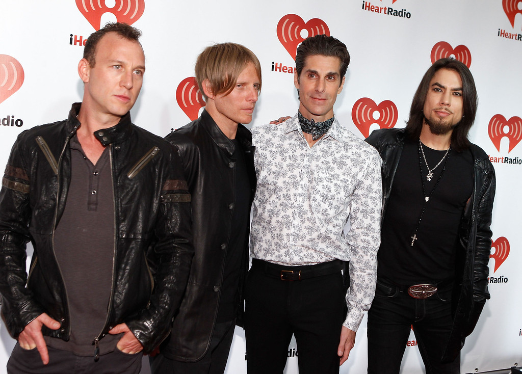 . LAS VEGAS, NV - SEPTEMBER 23:  (L-R) Stephen Perkins, Chris Chaney, Perry Farrell and Dave Navarro of Jane\'s Addiction pose backstage at the iHeartRadio Music Festival held at the MGM Grand Garden Arena on September 23, 2011 in Las Vegas, Nevada.  (Photo by Michael Buckner/Getty Images for Clear Channel)