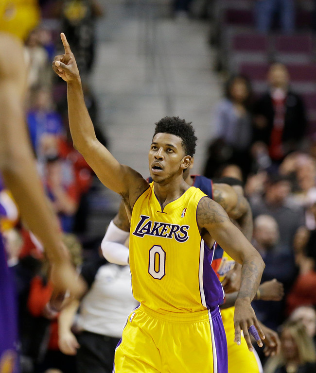 . Los Angeles Lakers  forward Nick Young (0) reacts after the Lakers defeated the Detroit Pistons 106-102 in an NBA basketball game at the Palace in Auburn Hills, Mich., Friday, Nov. 29, 2013. (AP Photo/Carlos Osorio)