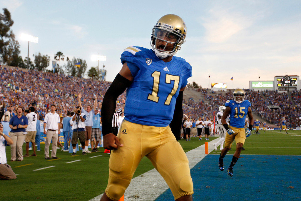 . UCLA QB Brett Hundley celebrates his 37-yard touchdown in the first quarter against Nevada, Saturday, August 31, 2013, at the Rose Bowl. (Michael Owen Baker/L.A. Daily News)