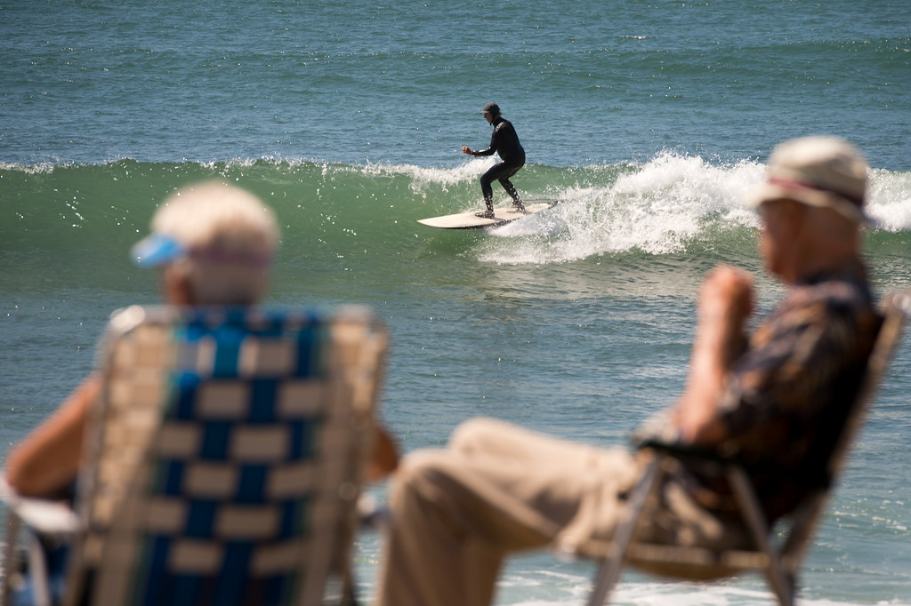 . Mieke Van Dyke and Bram, of Santa Clarita, have a front row to watch surfers at Surfer\'s Point in Ventura, Tuesday, August 26, 2014. (Photo by Michael Owen Baker/Los Angeles Daily News)