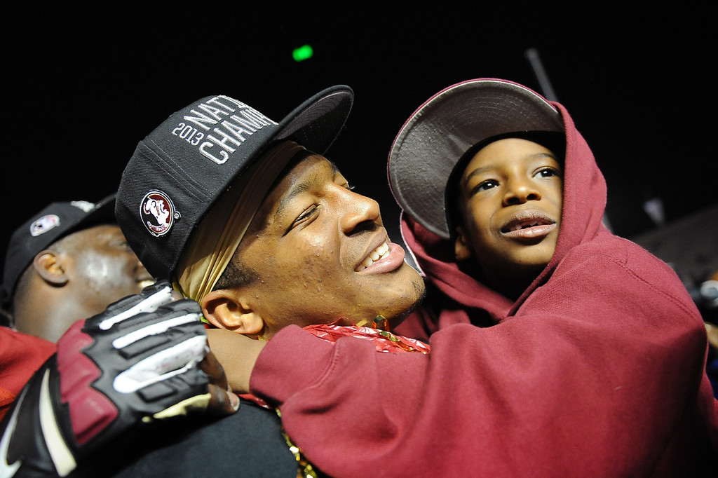 . Florida State quarterback Jameis Winston celebrates with his brother Jonah at the end of the 2014 Vizio BCS National Championship January 6, 2014 in Pasadena CA.  Florida State won the game 34-31.(Andy Holzman/Los Angeles Daily News)
