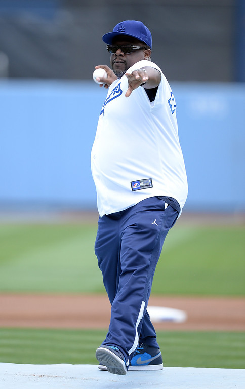 . Cedric the Entertainer throws out the ceremonial first pitch before the game between the St. Louis Cardinals and the Los Angeles Dodgers at Dodger Stadium on May 26, 2013 in Los Angeles, California.  (Photo by Harry How/Getty Images)