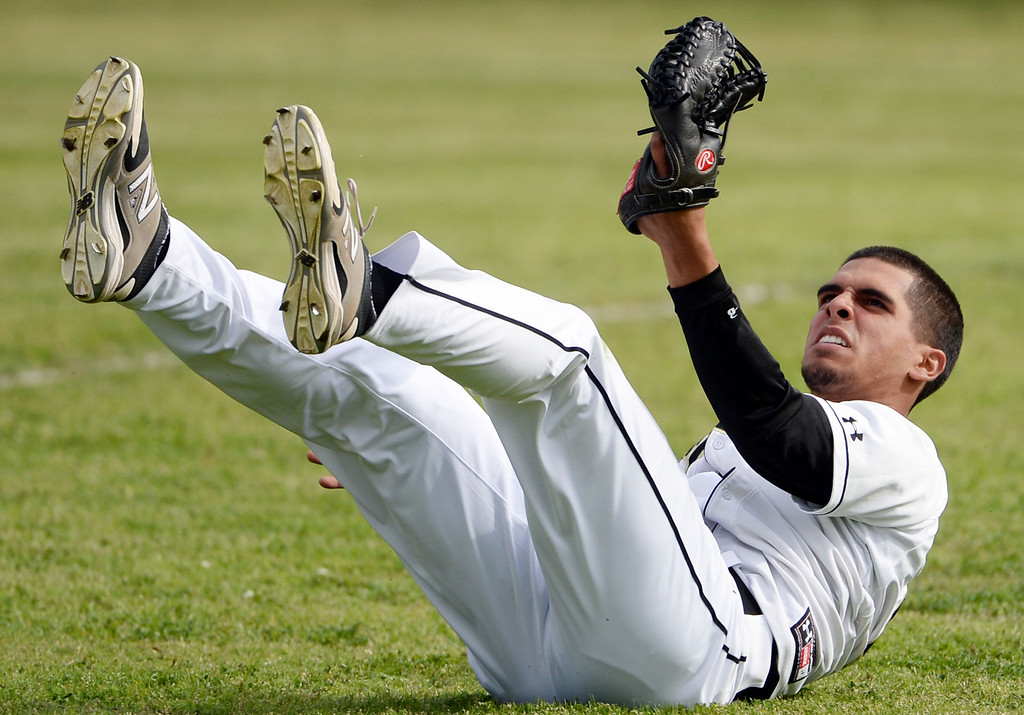 . Northview\'s Daniel Valencia catches a drive by San Dimas\' Jacob Castillo (not pictured) in the fifth inning of a prep baseball game at Northview High School in Covina, Calif., on Wednesday, March 26, 2014. San Dimas won 2-0. (Keith Birmingham Pasadena Star-News)