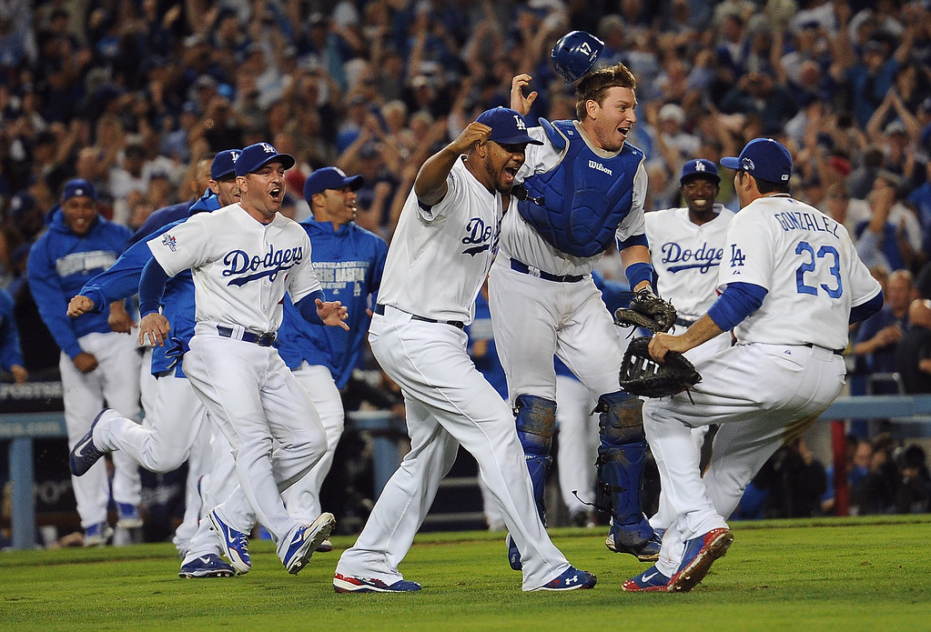 . The Los Angeles Dodgers run on to the field after beating the Atlanta Braves during game 4 of the NLDS at Dodger Stadium Monday, October 7, 2013. The Dodgers beat the Braves 4-3.(Photo by Hans Gutkencht/Los Angeles Daily News)