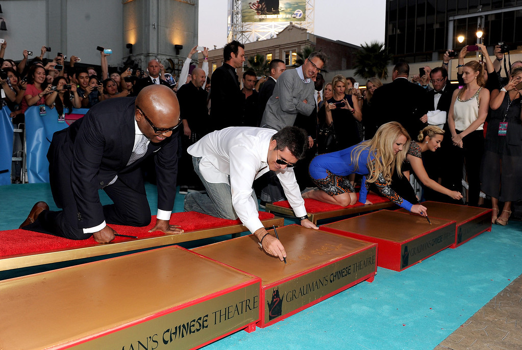 ". HOLLYWOOD, CA - SEPTEMBER 11: (L-R) Judges L.A. Reid, Simon Cowell, Britney Spears and Demi Lovato at ""The X Factor\"" Season 2 Premiere and handprint ceremony at Grauman\'s Chinese Theatre on September 11, 2012 in Hollywood, California. (Photo by Frank Micelotta/PictureGroup) via AP IMAGES"