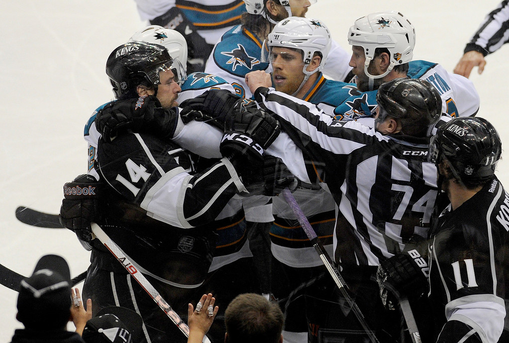 . A fight breaks out on the boards in the 3rd period. The Kings defeated the San Jose Sharks 2-0 in the first game of the Second Round of the Western Conference Playoffs. Los Angeles CA 5/14/2013(John McCoy/LA Daily News)