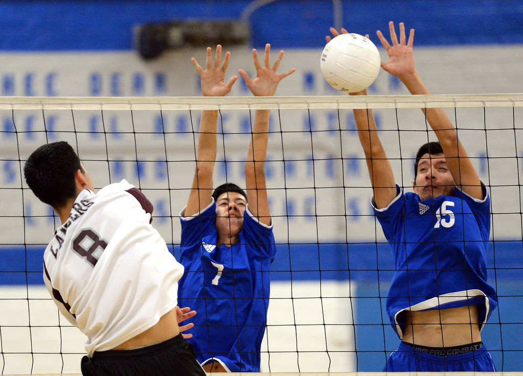 . El Rancho\'s Anthony Arauz-Diaz (#7) and Bryan Rojas (#15) block a shot from Bell Gardens\'s Charlie Hernandez (#8) in their non-league game at El Rancho High School in Pico Rivera on Friday March 28, 2014. Bell Gardens defeated El Rancho 3-2 games. (Staff Photo by Keith Durflinger/Whittier Daily News)