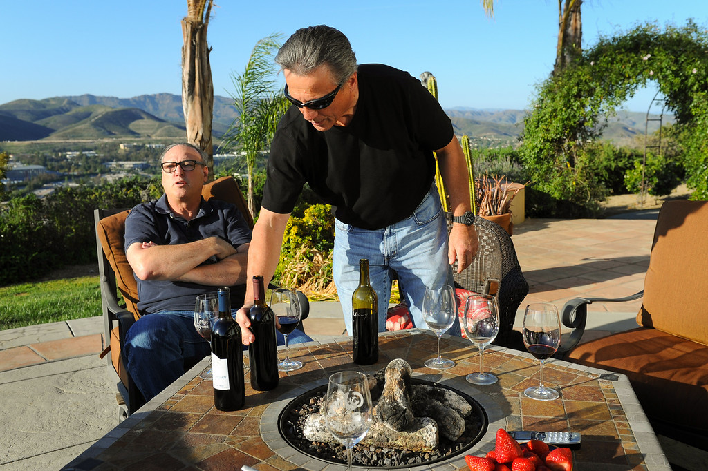 . Jeff Canter, left, and Chet Schreiber sample wine at Schreiber\'s Westlake home, Thursday, April 24, 2014. (Photo by Michael Owen Baker/L.A. Daily News)