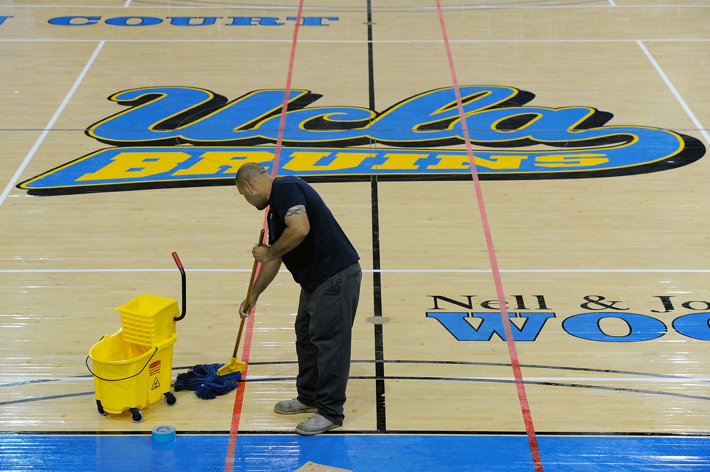 . Ruben Montes mops the floor at UCLA\'s Pauley Pavilion, Wednesday, July 30, 2014. (Photo by Michael Owen Baker/Los Angeles Daily News)