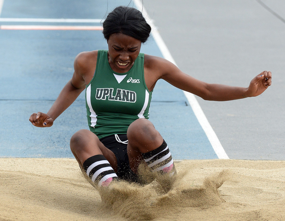 . Upland\'s Prisca Diala competes in the division 1 triple jump during the CIF Southern Section track and final Championships at Cerritos College in Norwalk, Calif., Saturday, May 24, 2014. 