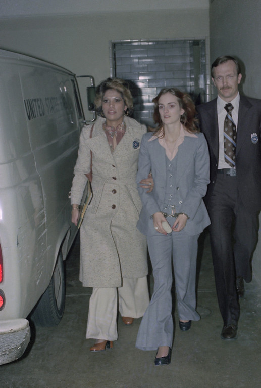 . Patty Hearst, daughter of California magnate Randolph Hearst, is escorted by U.S. Marshalls while leaving San Francisco Federal Building where she was on trial  on February 27, 1976.    Marshal at left is Janey Jimenez.       (AP Photo)