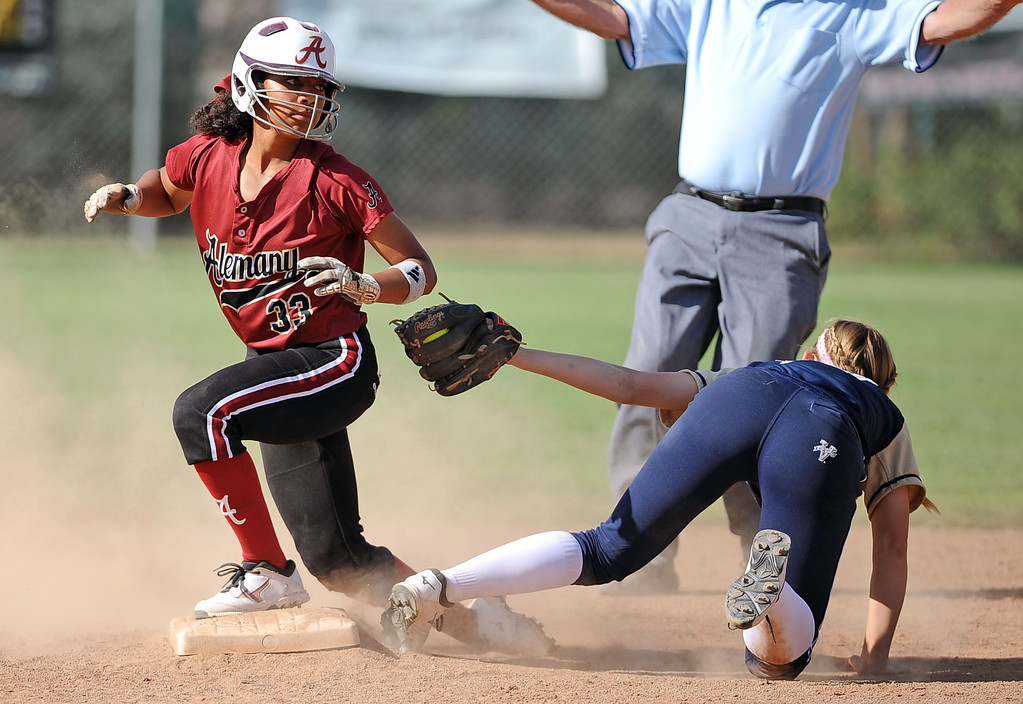. Alemany\'s Madison Collins is safe at 2nd behind the tag of Notre Dame\'s Emily Waters during their Mission League softball showdown in Encino, CA April 8, 2014.  Alemany won the game, 5-4.(Andy Holzman/Los Angeles Daily News)