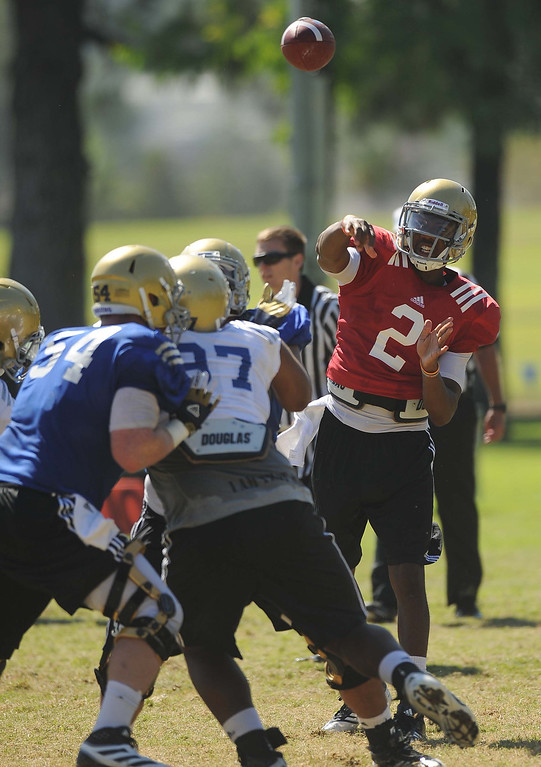 . Quarterback Asiantii (cq) Woulard (2) makes a pass during UCLA football practice held at California State University San Bernardino August 14, 2013.LaFonzo Carter/ Staff Photographer