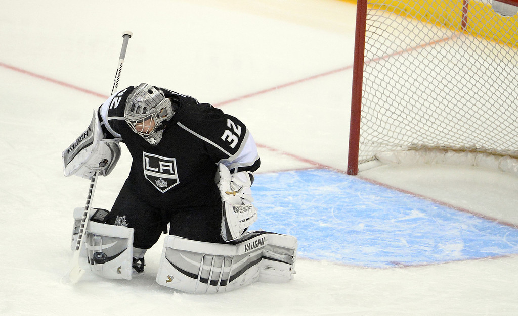 . Los Angeles Kings goalie Jonathan Quick blocks a shot against San Jose Sharks during the first period in Game 4 of an NHL hockey first-round playoff series at Staples Center in Los Angeles on Thursday, April, 24  2014.  (Keith Birmingham Pasadena Star-News)