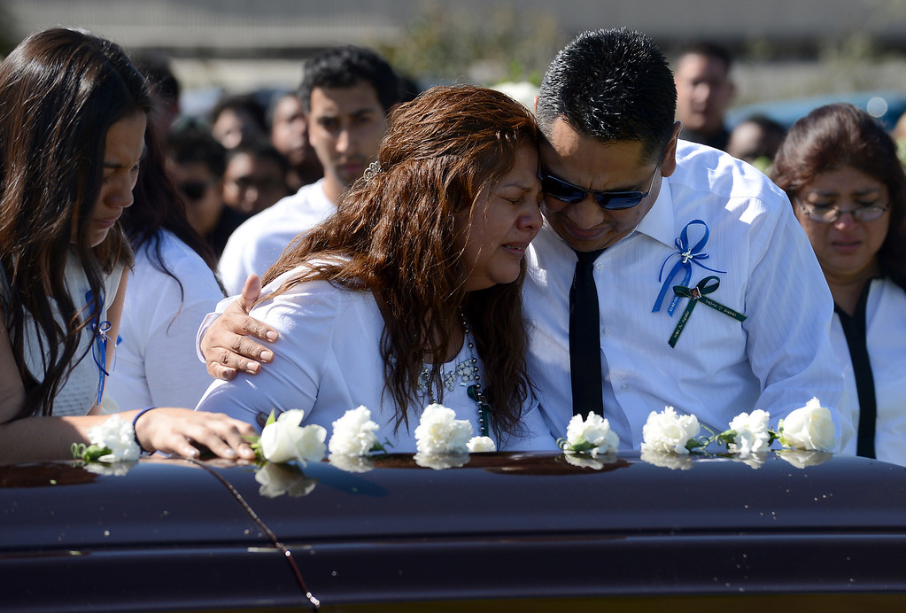 . Argelia and Raul Aguilar mourn at the casket for their son, Ivan Arturo Aguilar, during funeral services Thursday, March 14, 2013, at Oakdale Memorial Park in Glendora. Aguilar was hit and killed by a car while riding his bike on campus at Cal Poly Pomona in Pomona.  (Staff photo/Inland Valley Daily Bulletin)