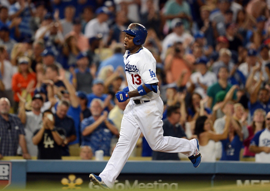 . The Dodgers\' Hanley Ramirez #13 heads for home after hitting  a 2-run homer in the 4th inning during their game against the Red Sox at Dodger Stadium Friday, August 23, 2013 in Los Angeles. (Hans Gutknecht/Los Angeles Daily News)