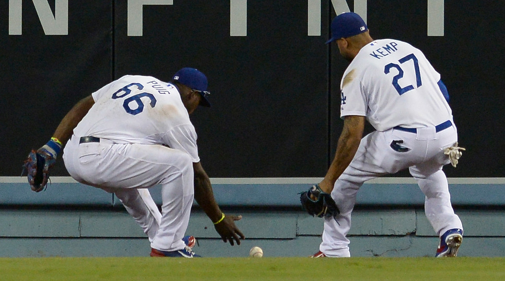 . Yasiel Puig and Matt Kemp converge before Puig picks up Padres Rymer Liriano double deep in center field in the 8th inning. The Dodgers lost to the San Diego Padres 4-1 at Dodger Stadium. Los Angeles, CA. 8/20/2014(Photo by John McCoy Daily News)