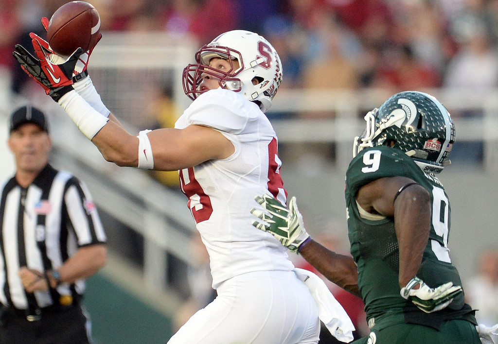 . Stanford wide receiver Devon Cajuste (89) catches a pass for 81 yard pass play over Michigan State safety Isaiah Lewis (9) in the second half of the 100th Rose bowl game in Pasadena, Calif., on Wednesday, Jan.1, 2014. Michigan State won 24-20.