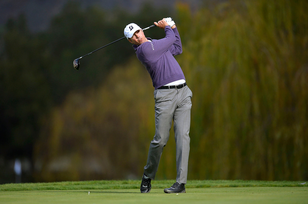 . Matt Kuchar hits a shot off the fifth tee during the second round of the Northwestern Mutual World Challenge golf tournament at Sherwood Country Club, Friday, December 6, 2013, in Thousand Oaks, Calif. (Andy Holzman/Los Angeles Daily News)
