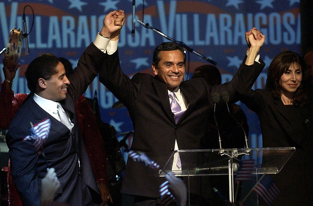 . Los Angeles Mayoral candidate Antonio Villaraigosa, center, celebrates with his wife Corina, right, and Los Angeles City Councilman Martin Ludlow at his election night celebration party in the Hollywood section of Los Angeles on Tuesday, March 8, 2005.  (AP Photo/Matt Sayles)