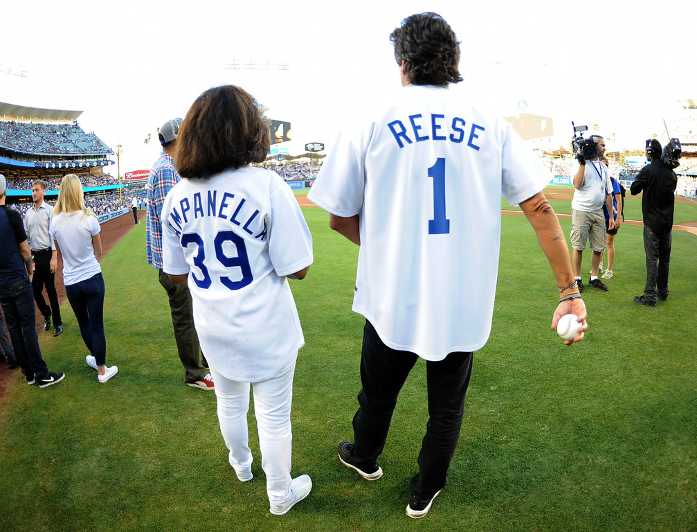 . Joni Campanella, left, daughter of Roy Campanella and Mark Reese son of Pee Wee Reese prepare to throw out the ceremonial pitch on their parents bobble head night prior to a Major league baseball game between the San Diego Padres and the Los Angeles Dodgers on Saturday, July 12, 2014 in Los Angeles.   (Keith Birmingham/Pasadena Star-News)
