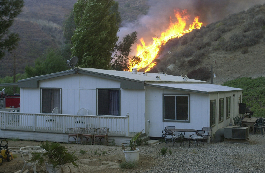 . VAL VERDE FIRE--Fire comes close to a home  along San Martinez Grande road Friday afternoon.    10.24.03   Photo by David Crane/Daily News
