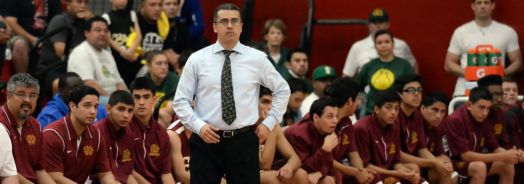 . Cantwell head coach George Zedan looks toward the scoreboard as time runs out as Bishop Montgomery defeated Cantwell 66-56 during a CIF Southern California Regional Division IV basketball game at Colony High School in Ontario, Calif., on Saturday, March 22, 2014.  (Keith Birmingham Pasadena Star-News)