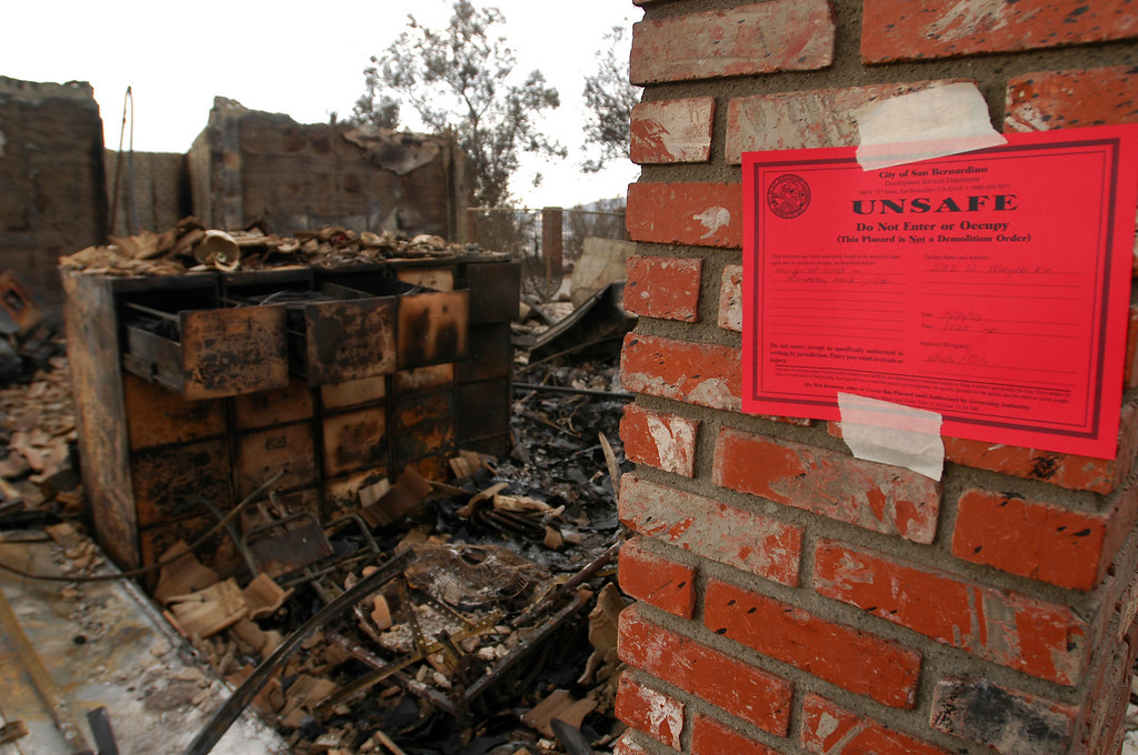 . Ten years ago this month the arson caused Old Fire, fanned by Santa Ana winds burned thousands of acres, destroyed hundreds of homes and caused six deaths. The fire burned homes in San Bernardino, Highland, Cedar Glen, Crestline, Running Springs and Lake Arrowhead and forced the evacuation of thousand of residents. One of many homes in the North Verdemont area of San Bernardino posted unsafe to return to after being destroyed by the Old Fire. (Staff file photo/The Sun)