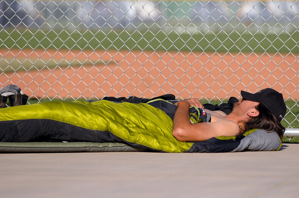 . A firefighter sleeps at a softball field at the command center at Freedom Park in Camarillo, Friday, May 3, 2013. (Michael Owen Baker/Los Angeles Daily News)