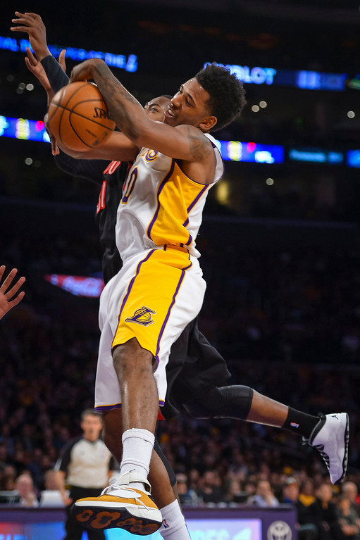 . Lakers� Nick Young and Raptors� DeMar DeRozan go for a rebound during second half action at Staples Center Sunday, December 8, 2013.  Lakers lost to the Raptors 94-106 as Bryant returned to action for the first time this season.  ( Photo by David Crane/Los Angeles Daily News )