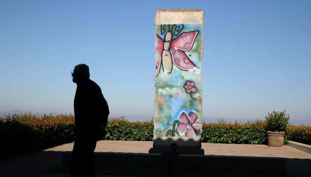 . A man stands near a portion of the Berlin Wall at the Ronald Reagan Library.   On June 5, 2014, the Ronald Reagan Presidential Foundation commemorated anniversaries with a special program at his Presidential Library that focused on his legacy and impact on the country after so many years since leaving office.  Wreath Laying Ceremony at President Reagan�s Gravesite included Secretary James Baker and Reagan Foundation Board Chairman Frederick J. Ryan, Jr. with the assistance of the Marine Corps League President Ronald Reagan Detachment. (Photo by Dean Musgrove/Los Angeles Daily News)