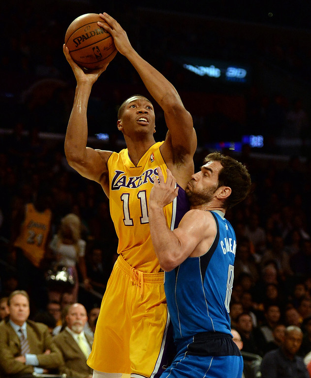 . Los Angeles Lakers forward Wesley Johnson (11) shoots over Dallas Mavericks guard Jose Calderon (8) in the first quarter during an NBA basketball game in Los Angeles, Calif., on Friday, April 4, 2014.  (Keith Birmingham Pasadena Star-News)
