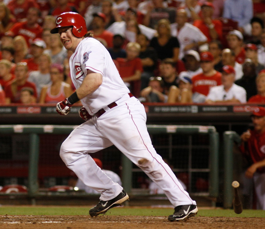 . Cincinnati Reds\' Ryan Hanigan watches his RBI game-winning double hit off Los Angeles Dodgers relief pitcher Ronald Belisario in the ninth inning during a baseball game, Sunday, Sept. 8, 2013, in Cincinnati. The Reds won 3-2. (AP Photo/David Kohl)