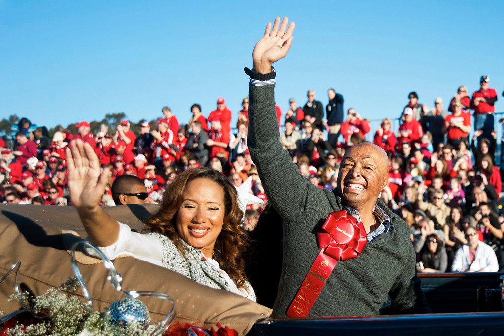 . Tournament of Roses Grand Marshal J.R. Martinez rides with girlfriend, Diana Jones, in a 1933 V-16 Cadillac All Weather Phaeton during the 123rd Rose Parade in Pasadena on Monday, January 2, 2012. (Watchara Phomicinda/Pasadena Star News)