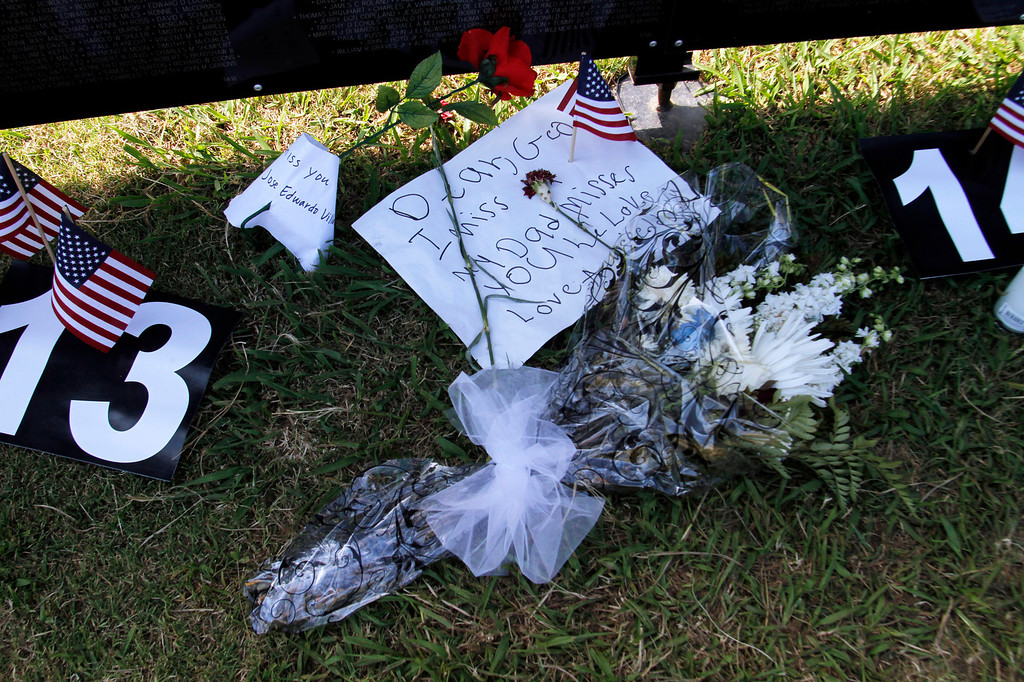 """. Notes and flowers are left under names on the Vietnam Veterans Memorial, during the Vietnam Veterans Memorial \""""The Wall That Heals\"""" Closing Ceremony event, at La Habra High School, in La Habra, Sunday, July 14, 2013. (SGVN/Correspondent Photo by James Carbone)"""
