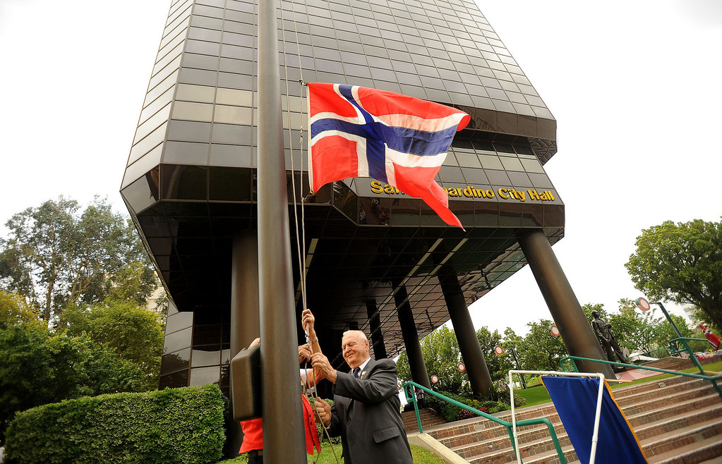 . Member\'s of the Sons of Norway raise the Norwegian flag during a celebration of Norway\'s Constitution Day in downtown San Bernardino May 17, 2013.  GABRIEL LUIS ACOSTA/STAFF PHOTOGRAPHER.