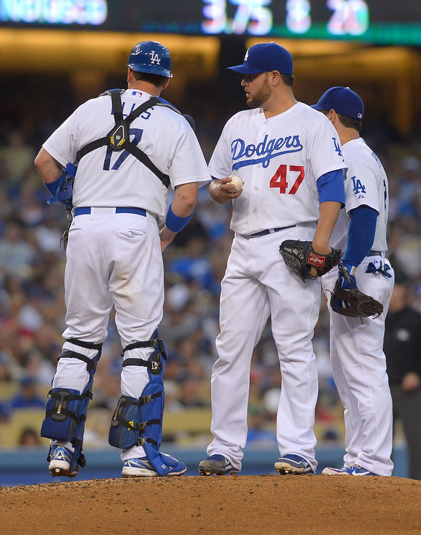 . Los Angeles Dodgers players gather aorund starting pitcher Ricky Nolasco during a two run Mets second inning August 12, 2013.  The Dodgers are in town hosting the Mets for a three game series.(Andy Holzman/Los Angeles Daily News)