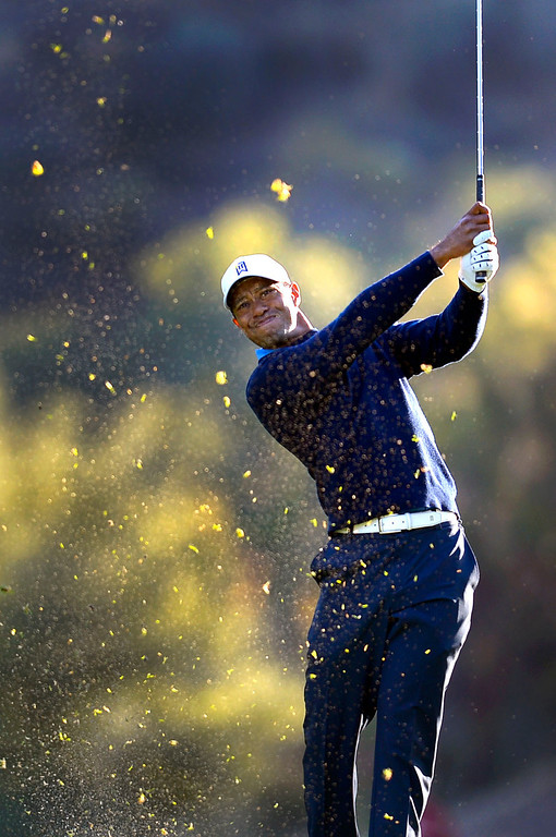 . Tiger Woods hits a shot during the first-round of Tiger Woods\' Northwestern Mutual World Challenge at Sherwood Country Club in Thousand Oaks, CA Thursday December 5, 2013.  Woods finished the day at  1-under par, 4 shots off the lead.(Andy Holzman/Los Angeles Daily News)