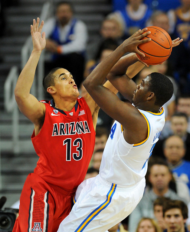 . Arizona\'s Nick Johnson plays tight defense on UCLA\'s Jordan Adams, Thursday, January 9, 2014, at Pauley Pavilion. (Photo by Michael Owen Baker/L.A. Daily News)