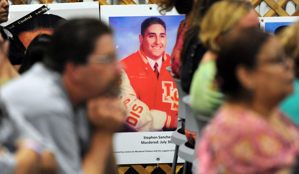 . A poster of Stephen Sanchez who was murdered as families listen to speakers during a Los Angeles County Sheriff�s Department and Justice for Murdered Children unsolved homicide summit at the Los Angeles County Sheriff\'s headquarters on Saturday, July 20, 2013 in Monterey Park, Calif.  (Keith Birmingham/Pasadena Star-News)