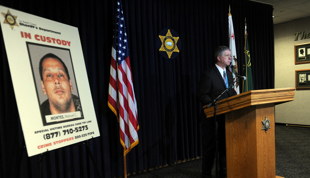 . Los Angeles County Sherriff\'s Sgt. Peter F. Hahn speaks to the media about seeking public\'s help in finding more victims of a Bassett man Manuel C. Montes, who was arrested on suspicion of lewd acts with children and distributing child porn, is shown during a news conference at the Los Angeles County Sheriff Headquarters in Monterey Park, Calif., on Friday, Feb.14, 2014. (Keith Birmingham Pasadena Star-News)
