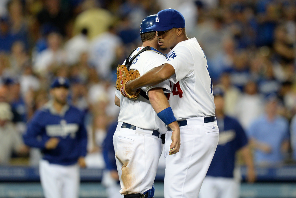 . The Dodgers� Kenley Jansen #74 and catcher A.J. Ellis #17  hug after winning their game at Dodger Stadium Thursday, August 21, 2014. The Dodgrs beat the Padres 2-1. (Photo by Hans Gutknecht/Los Angeles Daily News)