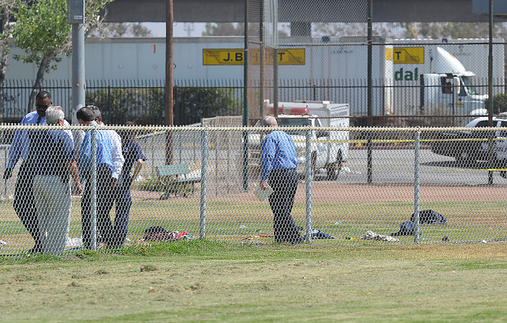 . San Bernardino police are investigating an officer-involved shooting that wounded a man Tuesday June 24, 2014 at Nunez Park. Officers responded to a call about a suspicious person. When the man failed to comply with officers� commands, and they fired non-lethal ammunition - bean bags - at him, the man grabbed the shotgun from the officer and attempted to hit the officer with the weapon. Other officers shot the man with their service weapons. The man is in stable condition at Arrowhead Regional Medical Center. (Rick Sforza/The Sun)