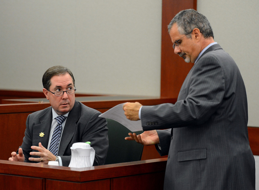 . O.J. Simpson defense attorney Ozzie Fumo, right, questions former Clark County district attorney David Roger at an evidentiary hearing for Simpson in Clark County District Court on Tuesday, May 14, 2013 in Las Vegas.  The hearing is aimed at proving Simpson\'s trial lawyer, Yale Galanter, had conflicted interests and shouldn\'t have handled Simpson\'s case. Simpson is serving nine to 33 years in prison for his 2008 conviction in the armed robbery of two sports memorabilia dealers in a Las Vegas hotel room. (AP Photo/Ethan Miller, Pool)