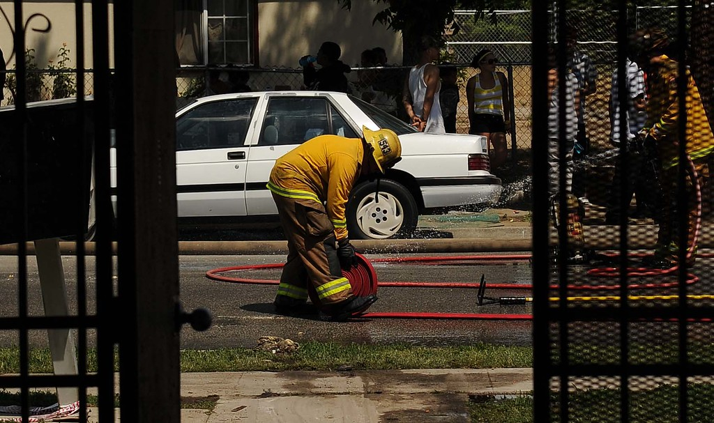 """. A mid-morning fire displaced 72 residents and damaged seven apartments Sunday.The apartment building was red tagged after the fire damaged 25 percent of the 16-unit complex in the 7400 block of Elm Street.\""""We feel very fortunate that all of the residents got out safely and with all the (hot temperatures) our firefighters didn\'t suffer from the heat,\"""" said Cal Fire spokesman Glenn Barley.LaFonzo Carter/ Staff Photographer"""