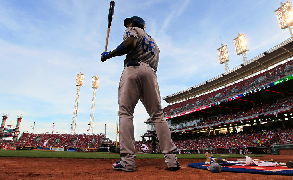 . Los Angeles Dodgers\' Yasiel Puig waits to bat against Cincinnati Reds starting pitcher Mike Leake in the first inning of a baseball game, Friday, Sept. 6, 2013, in Cincinnati. (AP Photo/Al Behrman)