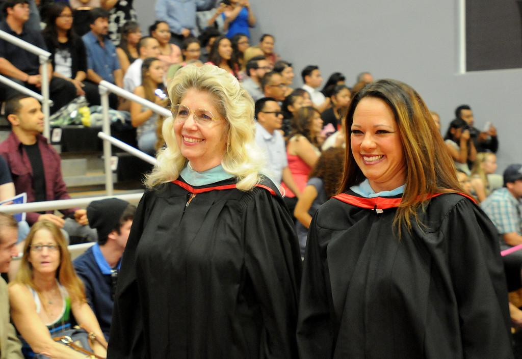 . Teachers enter the gymat the Northridge Academy High School graduation ceremony enter the CSUN gym on Thursday, June 5, 2014. (Photo by Dean Musgrove/Los Angeles Daily News)